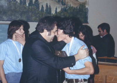 Fr. Sam Poulous and Fr. Ted Phillips celebrate together while Marilyn Kromydas Yeatts looks on at the 1978 FDF Awards Ceremony